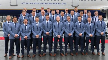 Iceland trolled over suits & shoes combo as Vikings venture to Russia for World Cup (VIDEO)
