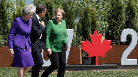 The disappearing PM: A G7 summit to forget for Theresa May, as she's upstaged by Trump and friends
