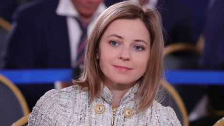 Natalya Poklonskaya, deputy chair of the State Duma Committee for Security listens to Vladimir Putin's annual Presidential Address to the Federal Assembly © Mikhael Klimentyev
