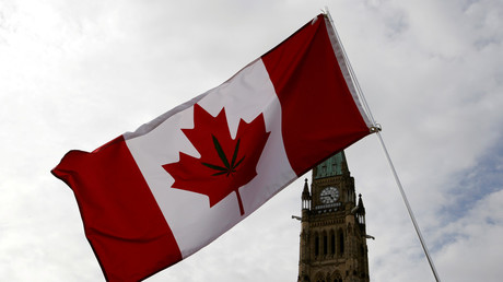 A Canadian flag with a marijuana leaf on it is seen during the annual 4/20 marijuana rally on Parliament Hill in Ottawa, Ontario, Canada, April 20, 2017 © Chris Wattie