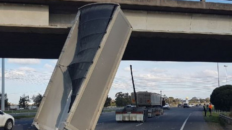 Barely-believable highway collision sees dump truck plow into bridge (VIDEO)