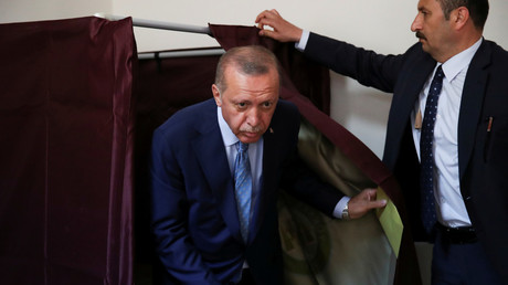 Turkish President Tayyip Erdogan leaves the voting booth at a polling station in Istanbul, Turkey on June 24, 2018. © Umit Bektas
