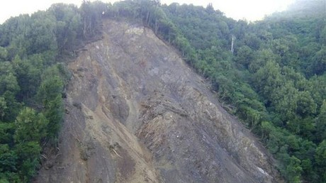 Rocky road: Motorist's miraculous escape from shocking landslide (VIDEO)