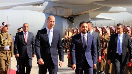 Jordanian Crown Prince Hussein (R) walks with Prince William upon his arrival at an airport in Amman, Jordan. © Mohammad Abu Ghosh/ Global Look Press