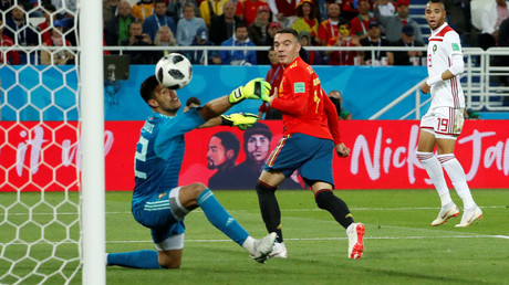 Spain score the winning goal in injury time.
