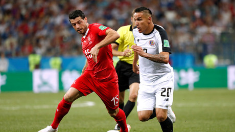 Costa Rica draw enough to send Swiss through to knockout stages