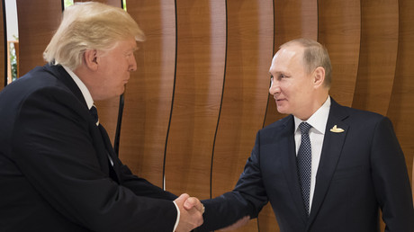 Donald Trump and Vladimir Putin shake hands at the G20 Summit in Hamburg, Germany, 7 July 2017 © Steffen Kugler