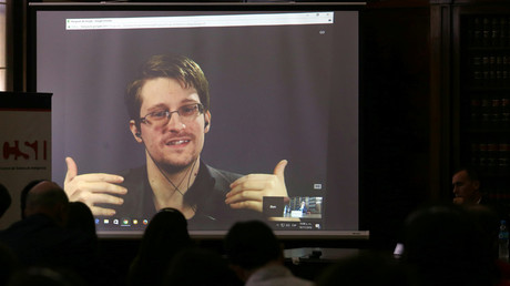 Edward Snowden speaks via video link during a conference at University of Buenos Aires Law School. © Marcos Brindicci