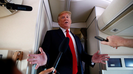 US President Donald Trump speaks to reporters on board Air Force One © Eric Thayer