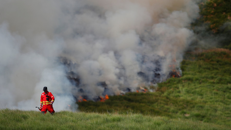 Arsonists spotted lighting fires only miles away from out-of-control moorland blaze