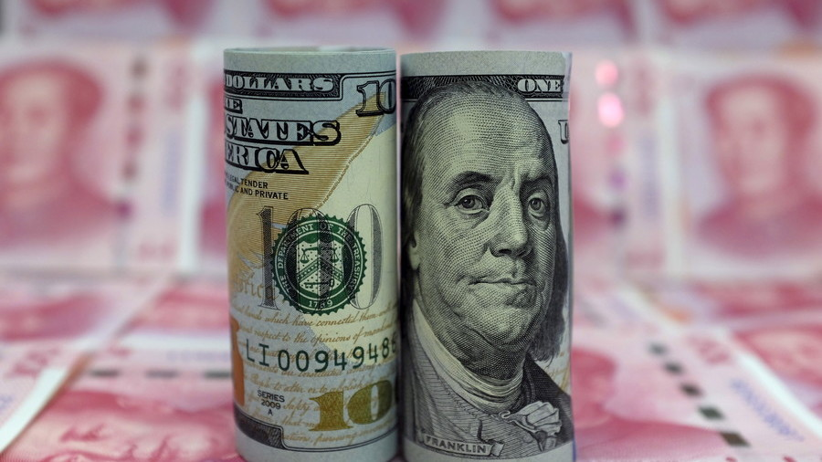 China pushes back against yuan slide, pledges stability