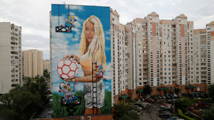 Russian businessman depicts his wife in 12-storey-high World Cup mural
