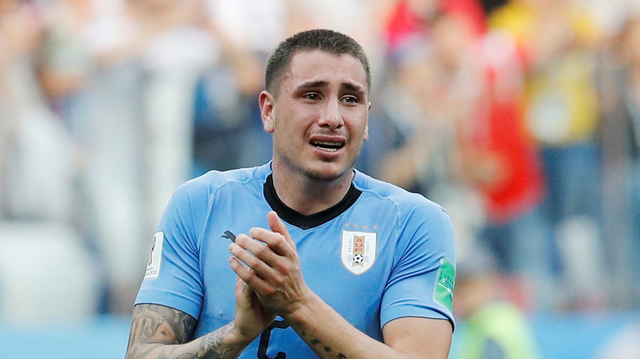 Uruguay defender Gimenez cries on pitch ahead of World Cup exit