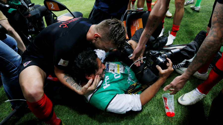 Croatian players send photographer sprawling amid wild World Cup winning goal celebrations