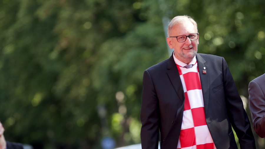 Croatia interior minister celebrates World Cup win by wearing team jersey to EU meeting