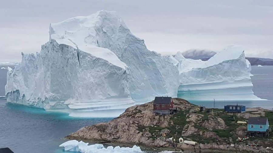 Massive iceberg drifts off, threatens Greenland village