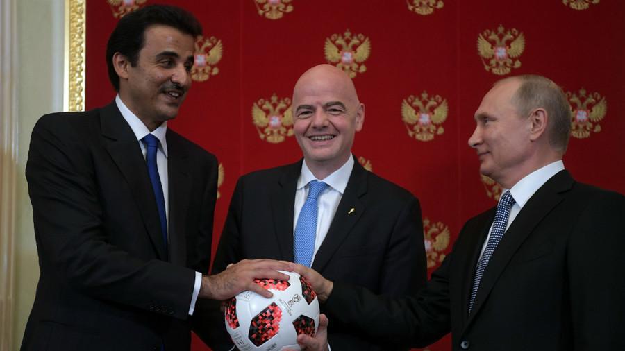 Putin hands World Cup host mantle to emir of Qatar