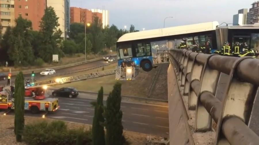 Bus left hanging off the edge of a bridge in Madrid crash (VIDEO)