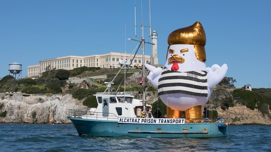 Giant Inflatable Trump Chicken Dressed in Prison Stripes Sets Sail Near Alcatraz
