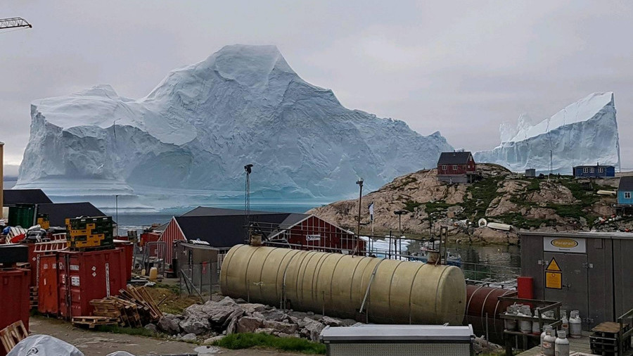 Iceberg from space: Epic satellite pics show 11mn-ton 'tsunami threat' beside Greenland village