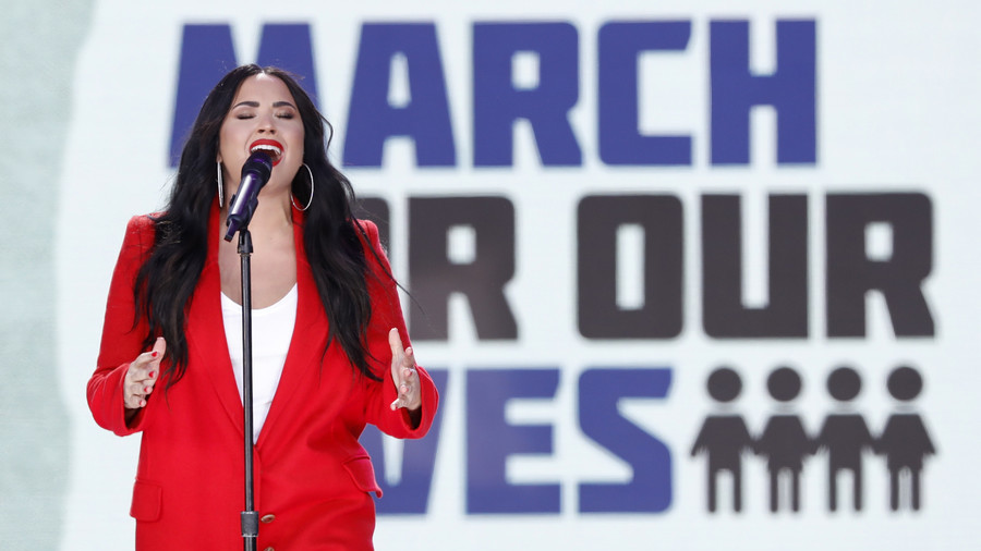 Lovato rep says singer is awake and with family