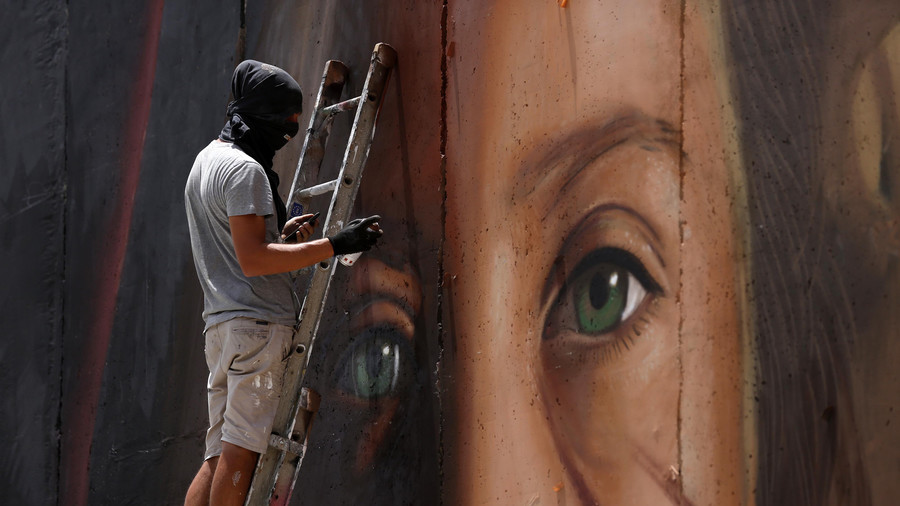 Italian artist who painted mural of Palestinian heroine Ahed Tamimi arrested in Israel