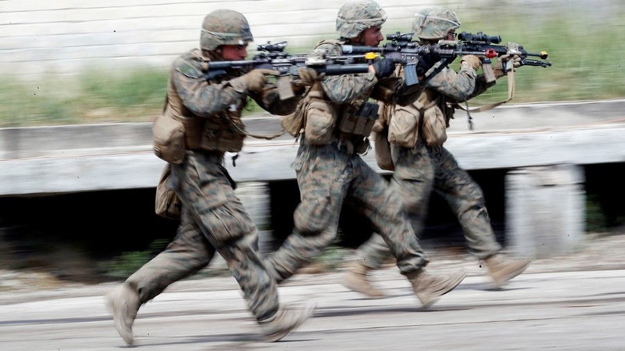 FILE PHOTO: U.S. soldiers take part at the urban fighting drill during the NATO Saber Strike exercise in the Soviet-time former military town near Skrunda, Latvia © Ints Kalnins