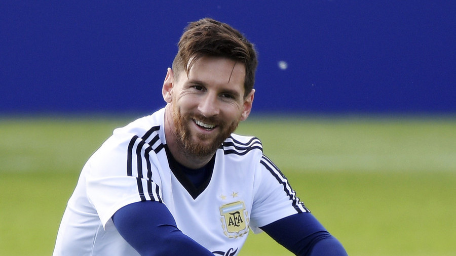 Man's best training partner: Messi plays football in the sunshine with his massive pet dog (VIDEO)