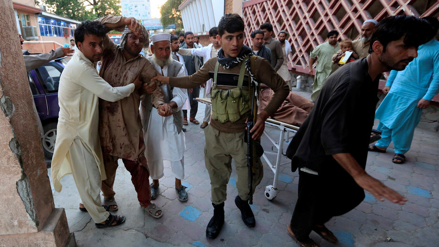 Gunmen storm Afghan government building, 15 die in bus bombing