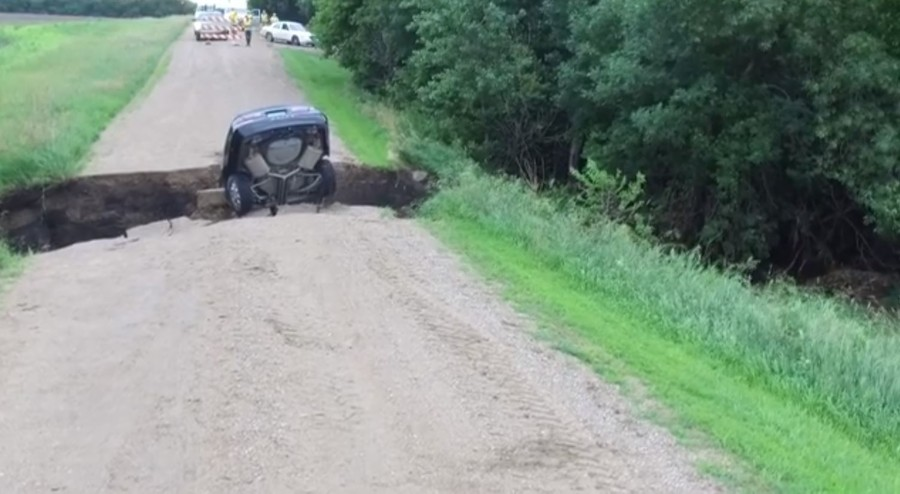 Giant sinkhole swallows motorist alive in stomach-churning incident (VIDEO)
