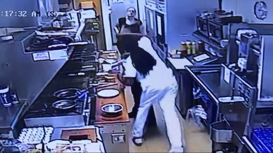 Kitchen worker pulls gun on man who 'brutally' sucker-punched her colleague (VIDEO)