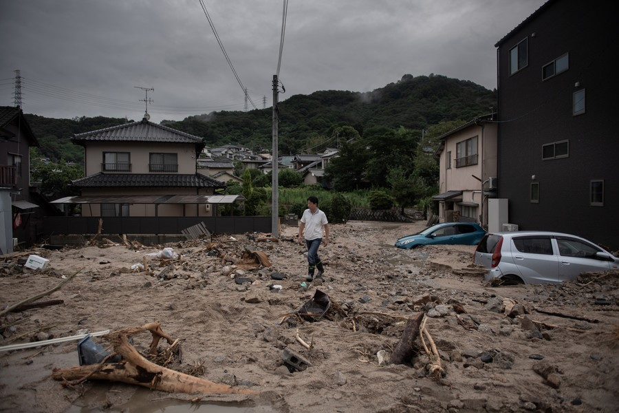 Historic flooding, landslides pose daunting task for rescuers as over 100 die