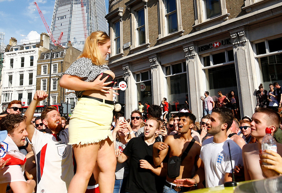 Cocaine atop lampposts & trashed ambulances: Orgiastic scenes from England's World Cup celebrations