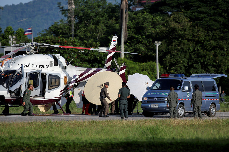 Rescued schoolboys are moved from a Royal Thai Police helicopter to an ambulance
