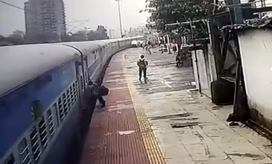 Passenger dragged by moving train in shocking CCTV footage (VIDEO)