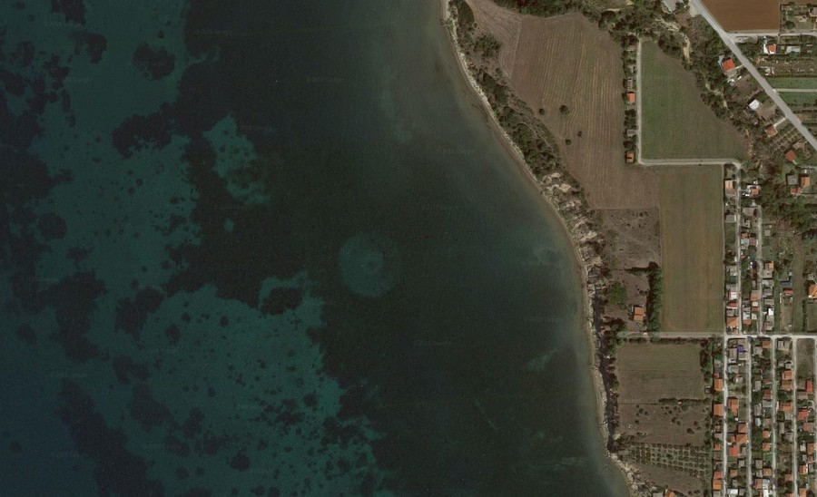 UFO or old pier? Satellite PHOTO of round object beneath water off Greek coast has internet guessing