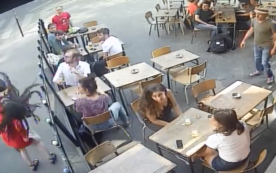 'Harassment is everyday': Wolf-whistling thug punches young woman outside Paris cafe (VIDEO)