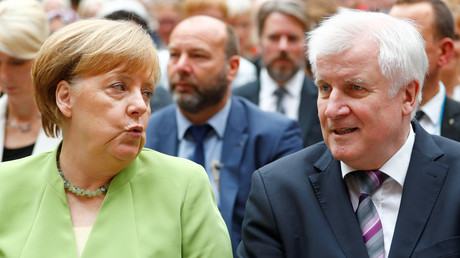 German Chancellor Angela Merkel and Interior Minister Horst Seehofer. © Hannibal Hanschke