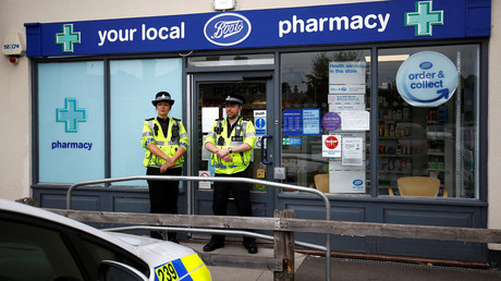 Police officers guard outside a branch of Boots pharmacy in Amesbury, UK © Henry Nicholls