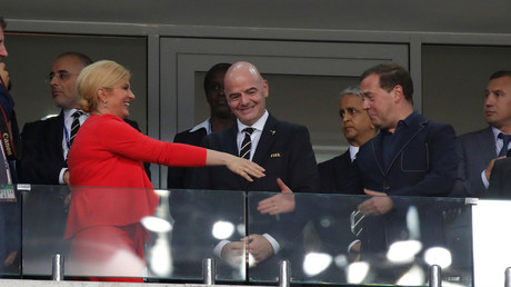 Russian Prime Minister, Croatian President shake hands at World Cup quarter final (PHOTOS)