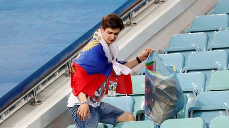 5b4133dfdda4c88e578b4576 Russian fans clean stands despite heartbreaking World Cup defeat to Croatia