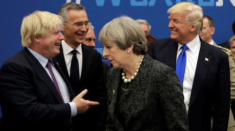 Boris Johnson (L), Donald Trump (R) near Theresa May (C) © Matt Dunham