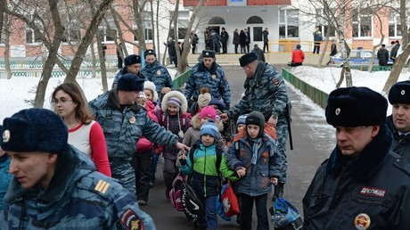 Police officers escort children out of Moscow School No. 263, which was entered by an armed student of the school's senior class © Maksim Blinov