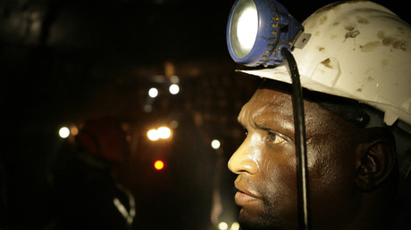 A mine worker looks on underground in Modderfontein east mine, outside Johannesburg © Siphiwe Sibeko