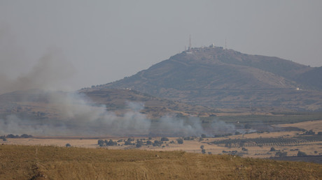 FILE PHOTO: Smoke rises over Golan Heights © Alaa al Faqir