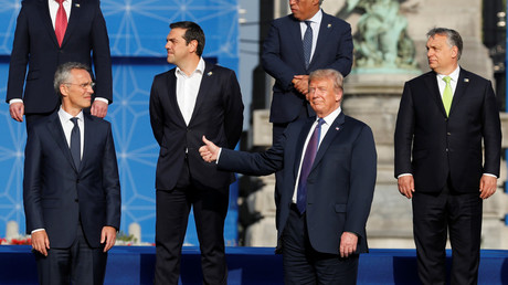 US President, Donald Trump, posing for a group photo with NATO leaders. © Yves Herman