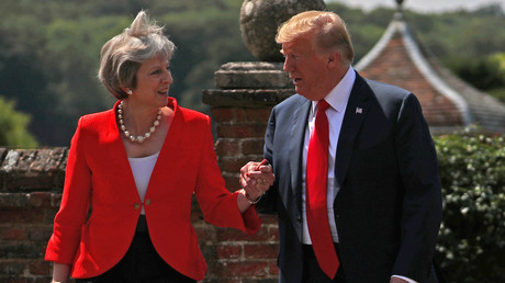 Theresa May and Donald Trump holding hands. © Hannah McKay