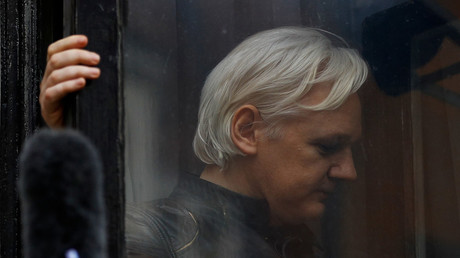 WikiLeaks founder Julian Assange on the balcony of the Ecuadorian Embassy in London. © Peter Nicholls