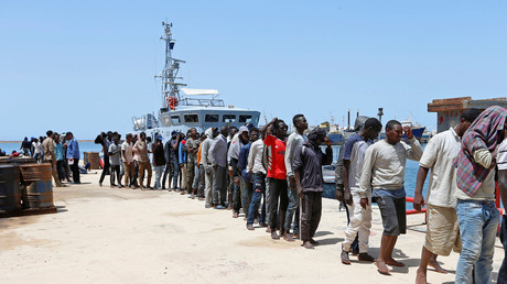 FILE PHOTO: Migrants arrive at a naval base after being rescued by Libyan coast guards in Tripoli, Libya June 29, 2018. © Ismail Zitouny