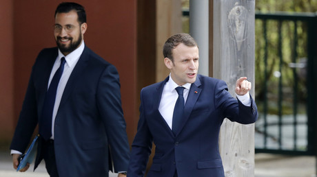 FILE PHOTO. French President Emmanuel Macron (R), next to Elysee Chief Security Officer Alexandre Benalla. © Charly Triballeau